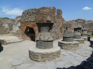 The ruins of a bakery (and its oven) in Pompeii